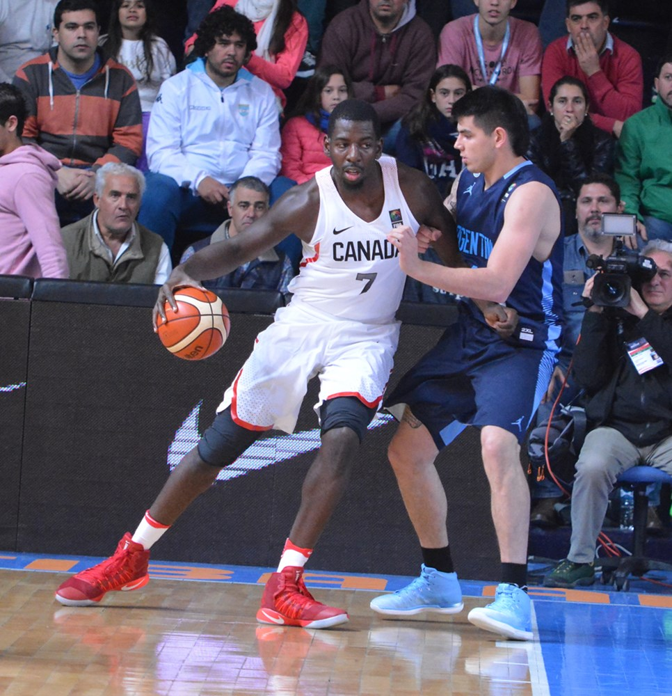 andrew nicholson backing down argentinas gabriel deck 2017 fiba americup