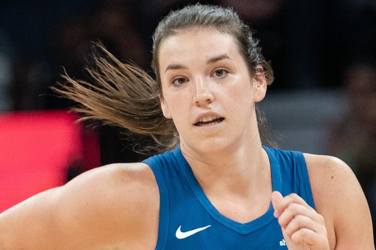 Bridget Carleton runs, wearing Minnesota Lynx uniform