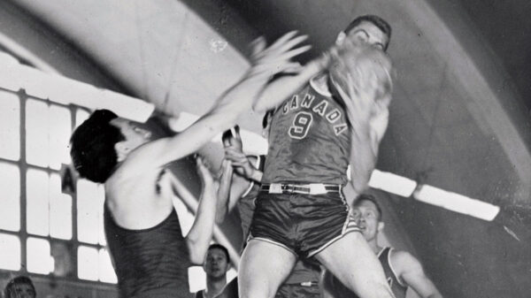 Canada Basketball at 1952 Olympics games in Helsinki, Finland. Canadian basketball player Bob Phibbs grabs rebound versus Italy