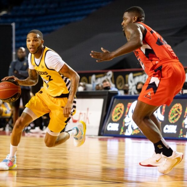 Edmonton Stingers guard Xavier Moon drives past Fraser Valley Bandits defender in the 2020 CEBL Summer Series