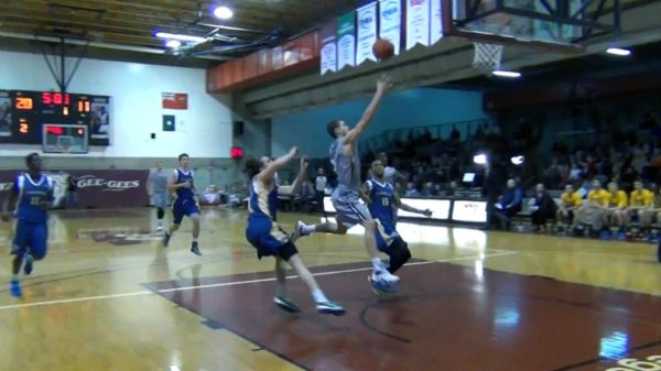 Gee-Gees Caleb Agada smashes alley-oop off the backboard on Laurentian