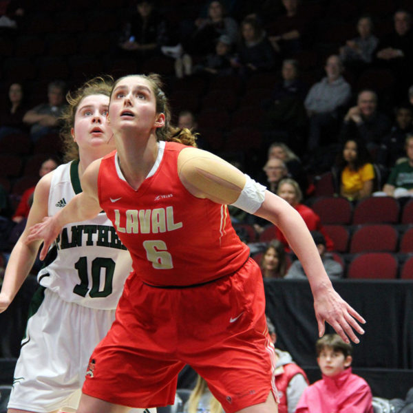 Laval's Khaleann Caron-Goudreau boxes out a UPEI player in the 2020 U Sports bronze medal game. Photo: Ben Forrest