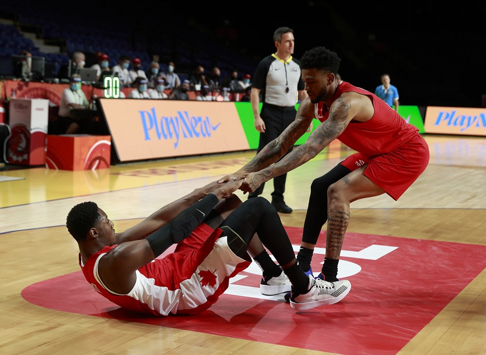 Nickeil alexander walker helps rj barrett back to his feet during team canada 97 91 victory over greece at the 2020 fiba olympic qualiying tournament in victoria