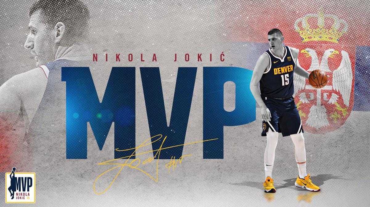 The joker nikola jokic holds the nba most valuable player card