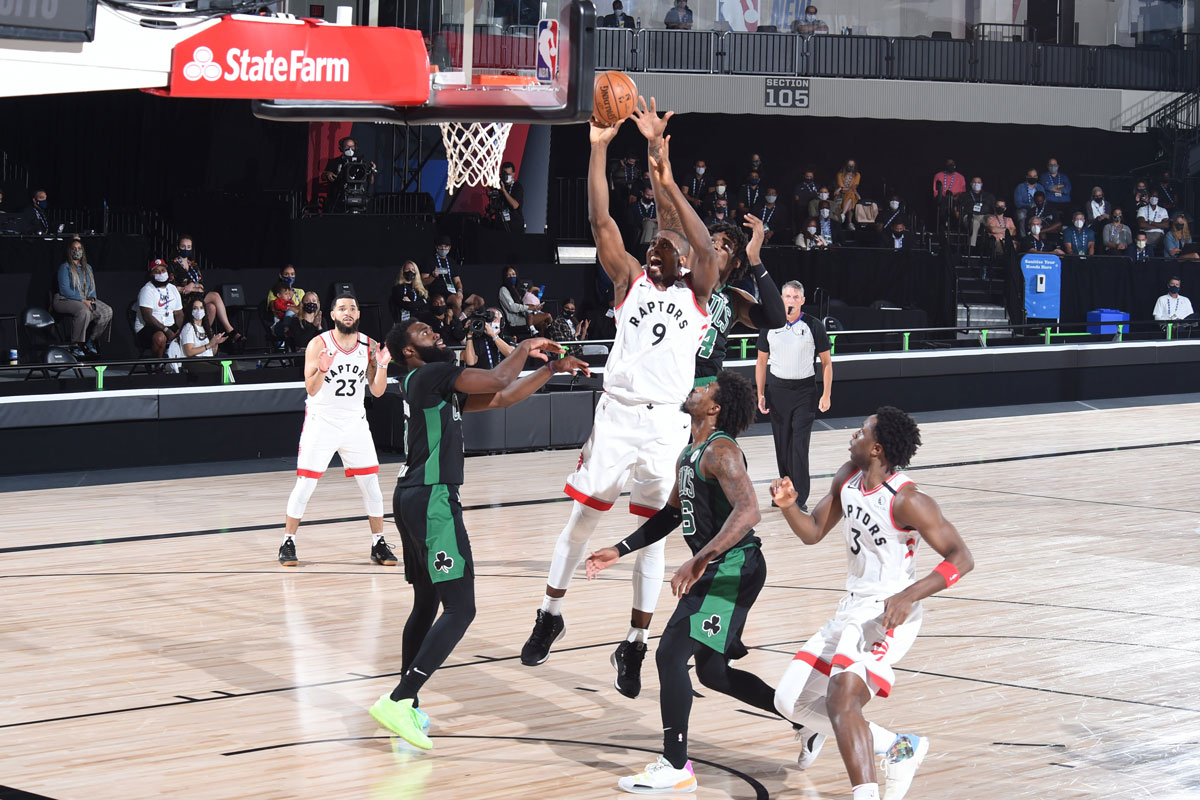 Toronto Raptors Serge Ibaka Fights Off Multiple Boston Celtics Defenders Grabs Offensive Rebound 2020 Nba Playoffs